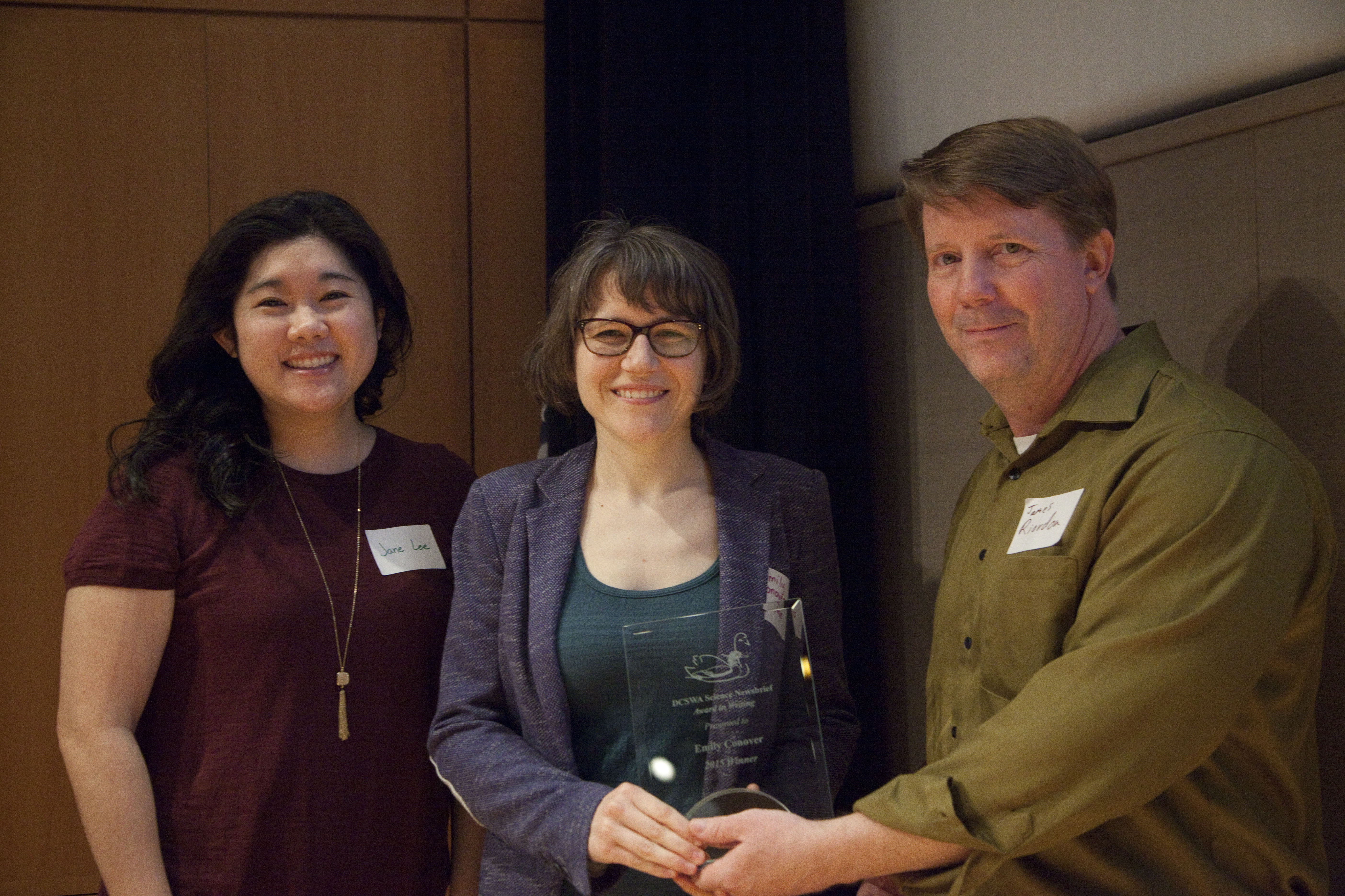 Emily Conover receives the 2015 writing award from judges Jane Lee and James Riordon. Photo by Rich Press